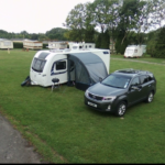 Caravan With Vehicle Parked Outside